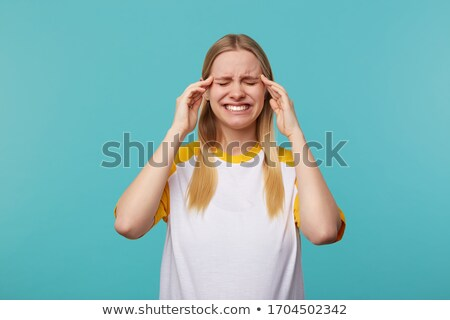Photo of young blond woman in basic clothing keeping fingers cro Stock photo © deandrobot