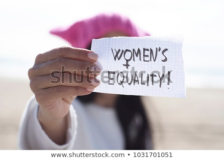 Stok fotoğraf: Woman With A Pink Hat And The Text Womens Rights