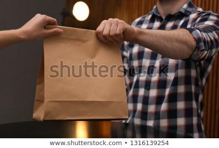 Człowiek torby papierowe kobieta młodych przystojny mężczyzna domu Zdjęcia stock © AndreyPopov