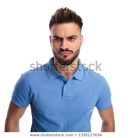 Young imature man wearing a light blue polo frowning Stock photo © feedough