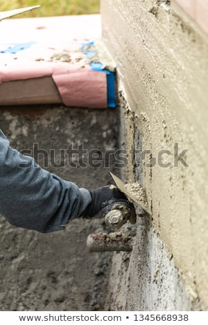 Tile Worker Applying Cement with Trowel at Pool Construction Sit Stock photo © feverpitch