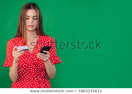Image of attractive young woman wearing casual clothing using si Stock photo © deandrobot