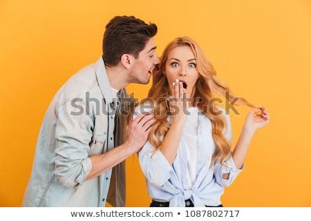portrait of brunette woman whispering secret or interesting goss stock photo © deandrobot