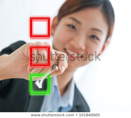 Stock photo: business woman drawing red cross check mark