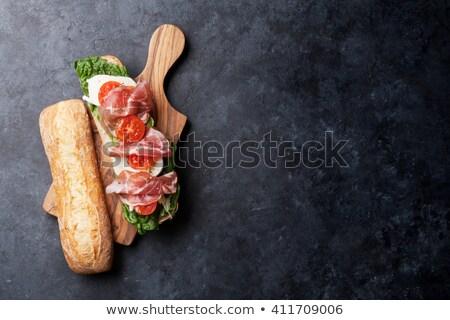 Slate board with prosciutto Stock photo © grafvision