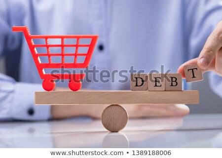 Bevásárlókocsi ikon adósság szó egyensúlyoz hinta Stock fotó © AndreyPopov