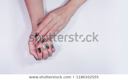 Stock photo: Manicure. Beautiful manicured woman's hands with red nail polish. Bottle of nail polish.Trendy red n