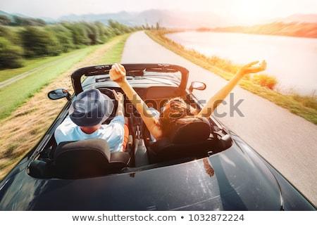 Szczęśliwy człowiek kobieta jazdy kabriolet samochodu Zdjęcia stock © dolgachov