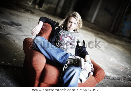 Cool girl sitting in old red sofa Stock photo © lichtmeister