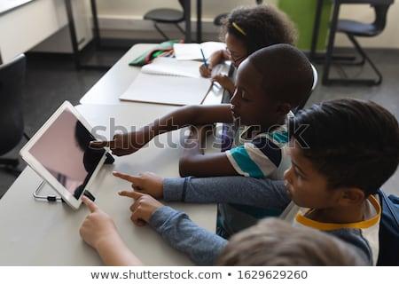 Ansicht Schulkinder Studium Schreibtisch Klassenzimmer Stock foto © wavebreak_media