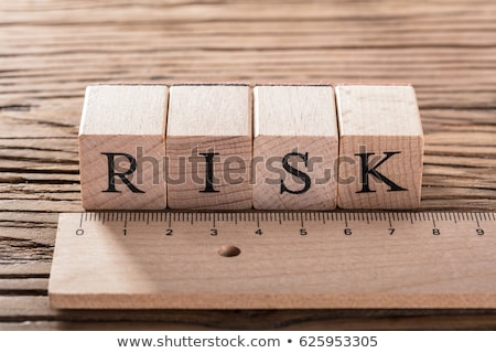 risk word on wooden blocks behind the ruler stock photo © andreypopov