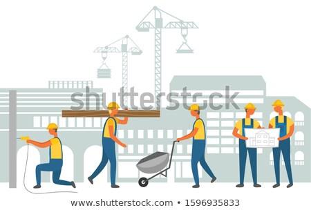 Man Working on Construction, Carrying Wood Bulk Stock photo © robuart