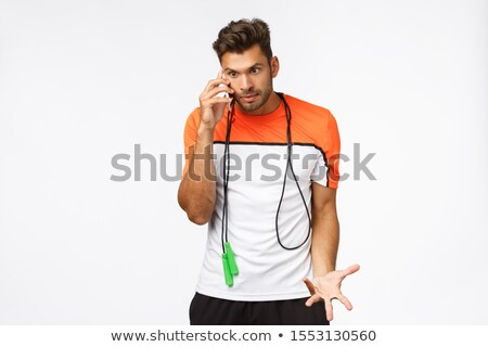 Bothered and disturbed annoyed sportsman feel angry someone called during training, answer call, hol Stock photo © benzoix