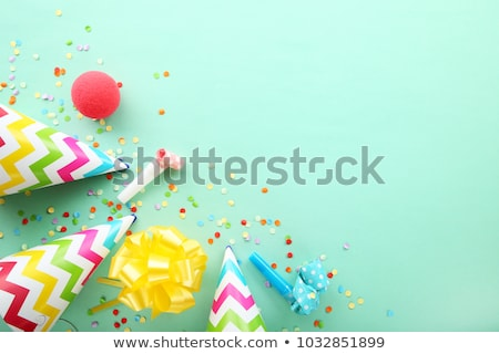 yellow birthday party cap and confetti Stock photo © dolgachov
