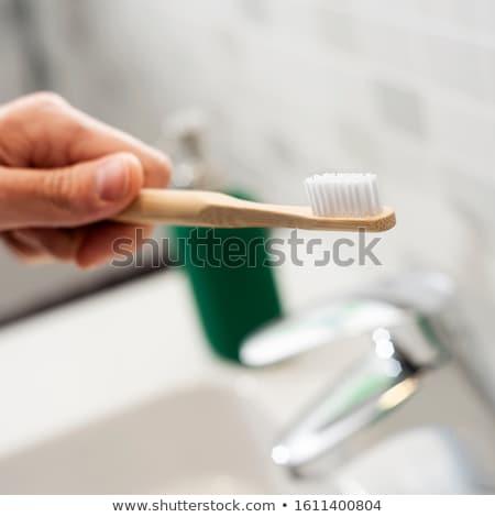 Férfi bambusz fogkefe fürdőszoba közelkép kaukázusi Stock fotó © nito
