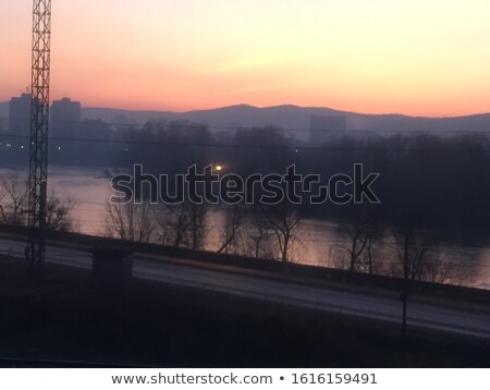 Red sky sunset over river with distant mountains  Stock photo © lovleah