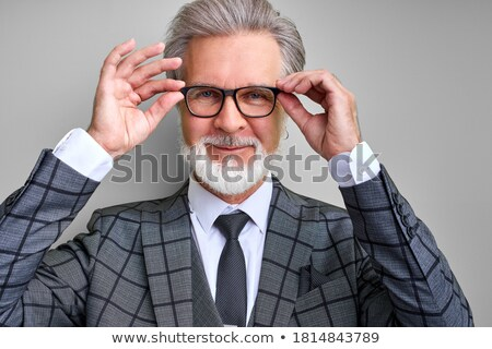 Portrait of handsome businessman posing and looking at camera Stock photo © deandrobot