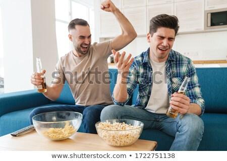 Foto jonge ongelukkig jongens fans kijken Stockfoto © deandrobot