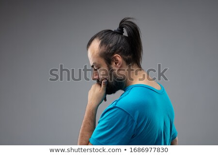 A man with ponytail, guessing gesture Stock photo © Giulio_Fornasar