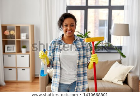 african woman with window detergent and sponge mop Stock photo © dolgachov
