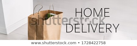 Home delivery safe contactless online shopping due to COVID-19. Grocery bag at entrance door banner  Stock photo © Maridav