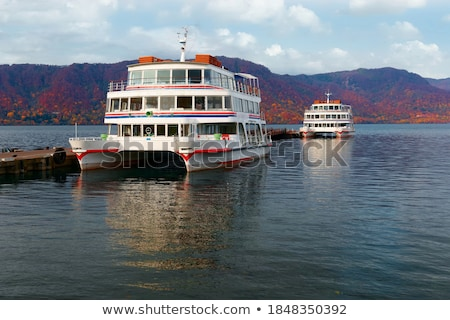colorful tour boats at lakeside stock photo © bbbar