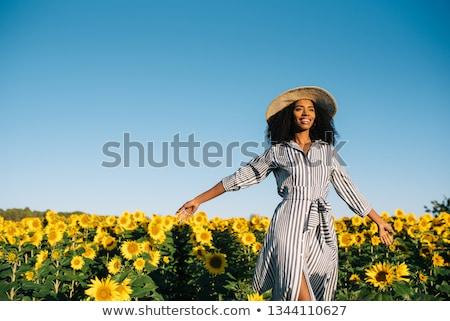 Beautiful girl in field with yellow flower Stock photo © RuslanOmega