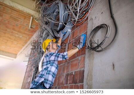 Foto stock: Trabajador · electricidad · hombre · construcción · pared
