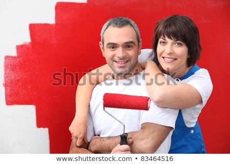 kobieta · malarstwo · ściany · czerwony · uśmiech · pracy - zdjęcia stock © photography33
