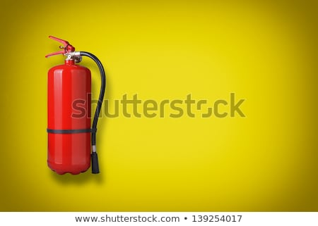 Fire extinguisher on the yellow wall Stock photo © HASLOO