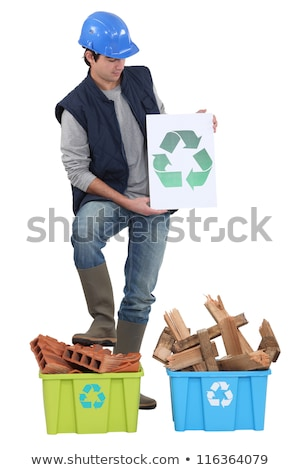 Builder stood by materials to be recycled Stock photo © photography33