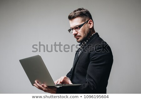 Man in suit holding laptop computer, studio shot stock photo © photography33