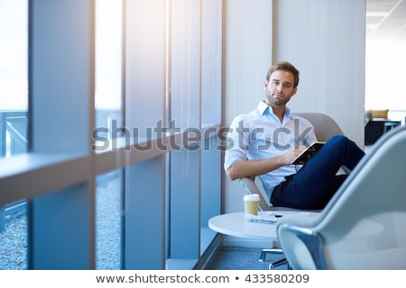 Stock photo: Man writing in his business diary