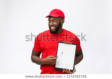 Delivery man requesting signature Stock photo © photography33