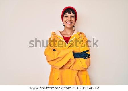 Mooie jonge vrouw regenjas poseren studio foto Stockfoto © Elmiko
