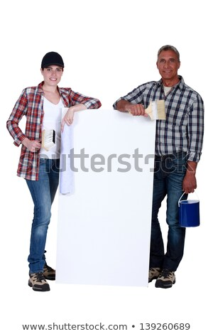 Stock photo: two painters holding a white ad board