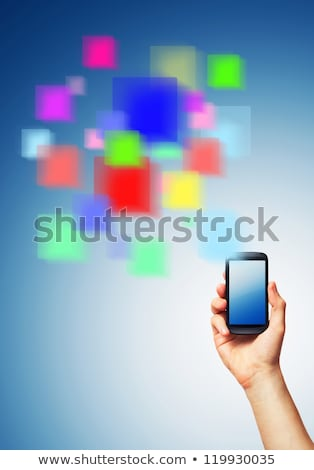 Cell phone and a futuristic digital depiction of social media ov stock photo © vlad_star