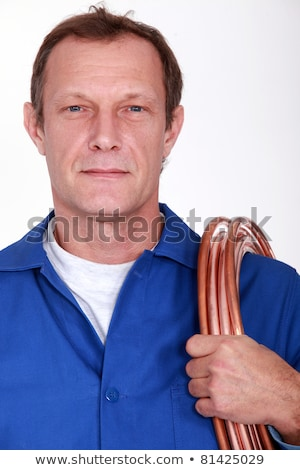 Man carrying coil of piping Stock photo © photography33
