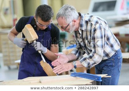 Artesão aprendiz trabalhando edifício construção cozinha Foto stock © photography33