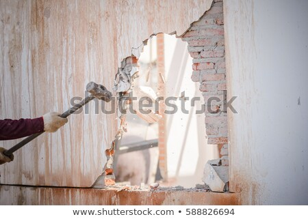 Mason smashing wall Stock photo © photography33