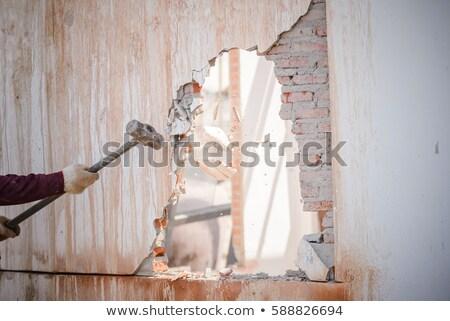mason smashing wall stock photo © photography33