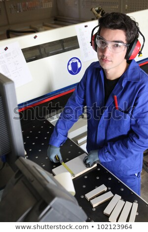 Young factory worker operating cutting machine Stock photo © photography33