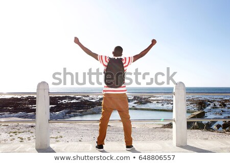 Young black man standing with arm on railing Stock photo © Schmedia