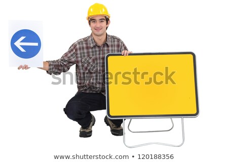 Man kneeling by two traffic signs Stock photo © photography33