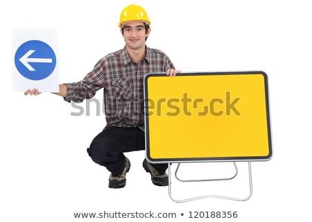 Férfi térdel kettő forgalom feliratok építkezés Stock fotó © photography33