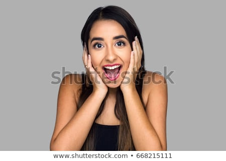Surprised teen girl. Stock photo © Massonforstock