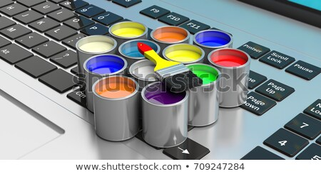 Decorator with laptop and tins of paint Stock photo © photography33
