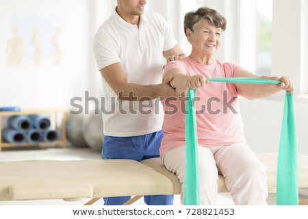 Nurse helping her patient to do exercises at home Stock photo © wavebreak_media