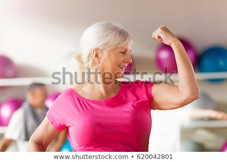 Woman showing off her biceps stock photo © dash