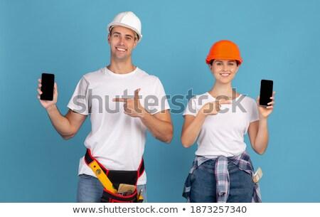 Dois jovem feliz mulheres azul tela Foto stock © rosipro